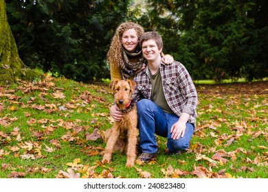 Young couple in the park with their dog