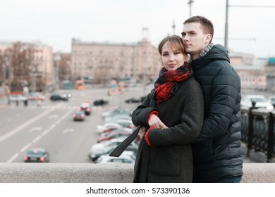 young couple at the park in winter view from the back