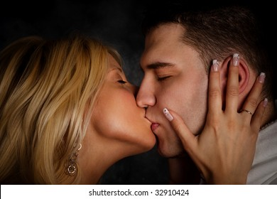 young couple in passion kiss, studio shot