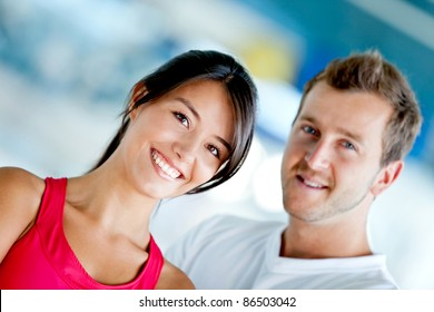 Young couple of people smiling at the gym