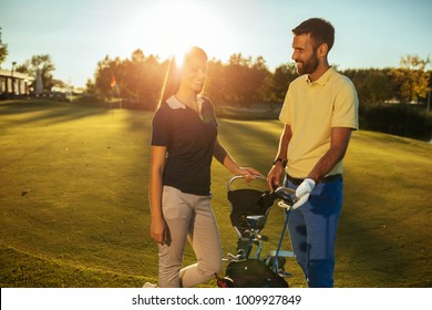 Young couple picking a club on a golf course