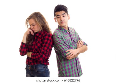 Young couple in plaid shirts
