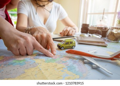Young couple planning honeymoon vacation trip with map. Top view.