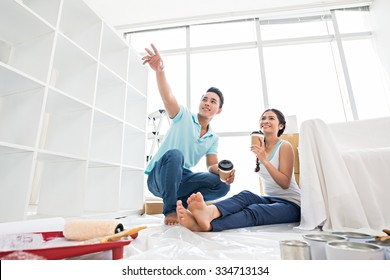 Young couple planning repairs of the new house