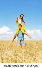 Young couple playing on wheat field