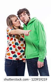 Young couple pointing at something