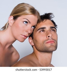 young couple portrait thinking naked in studio on isolated grey background