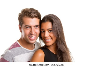 Young couple posing isolated in studio