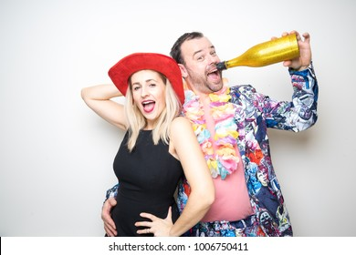 young couple posing photo studio shoot booth props happy celebration party wedding