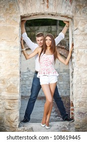 Young couple posing in a ruined building