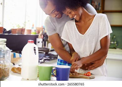 Young Couple Preparing Breakfast In Kitchen Together