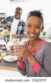 Young Couple Preparing Breakfast In Modern Kitchen