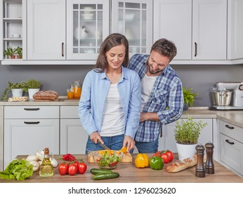 Young couple preparing a salad