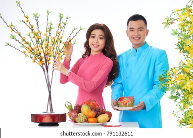Young couple preparing table for spring festival celebration