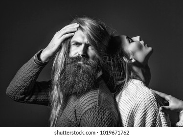 Young couple of pretty girl or beautiful sexy woman with long messy hair on head and face of bearded handsome man with beard and moustache on grey background