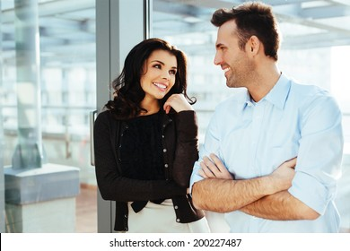 Young couple of professionals having a conversation