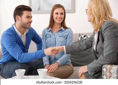 Young couple with psychologist family therapy shaking hands