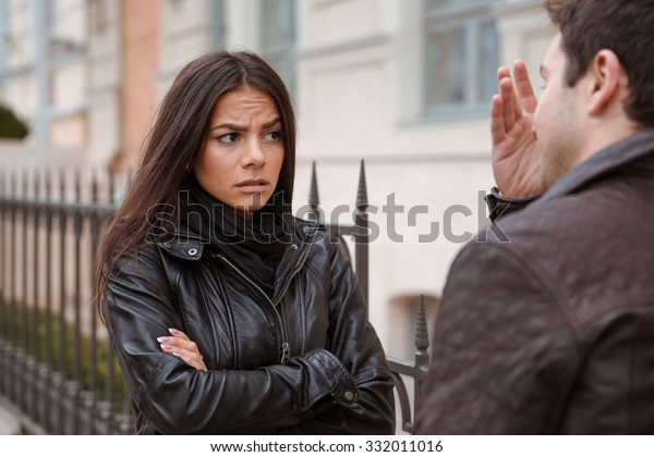 Young couple quarreling outdoors