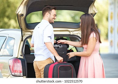 Young couple is ready to travel by car.
