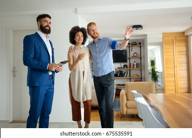 Young couple with real estate agent. Buying a new house.