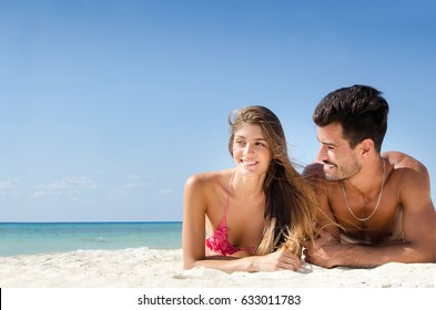Young couple relaxing at the beach
