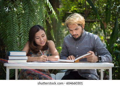 Young couple relaxing at home garden together.