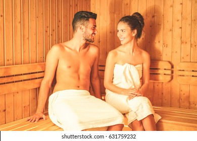 Young couple relaxing inside a sauna for cleaning and refreshing the body at spa resort hotel luxury - Romantic lovers having a body care day in steam bath - Concept of healthy and vacation