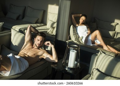 Young couple relaxing on the bed
