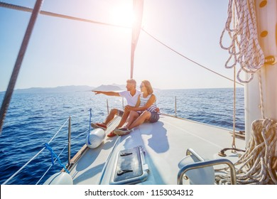 Young couple relaxing on the yacht cruise. Travel adventure, yachting vacation.