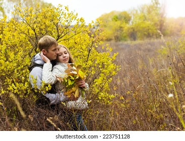 Young couple relaxing outdoors in autumn