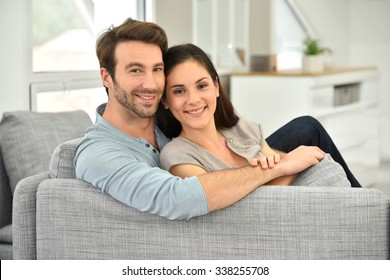 Young couple relaxing in sofa
