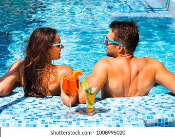 Young couple are relaxing at swimming pool party. Summer vacation concept