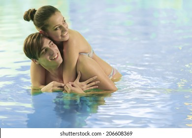 Young couple relaxing in the swimming pool