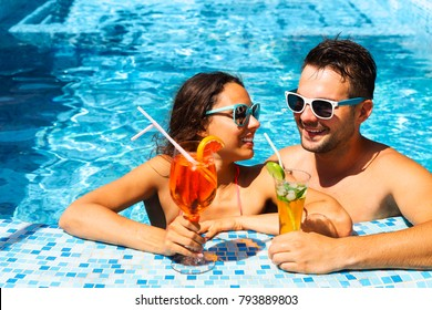 Young couple are relaxing in swimming pool party. Summer vacation concept