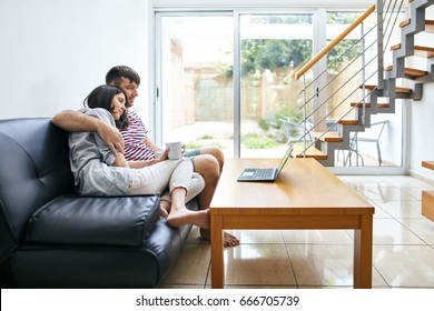 Young couple relaxing and watching movie at home. family concept