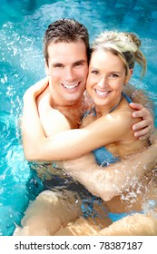 Young couple relaxing in the water.  Summer.