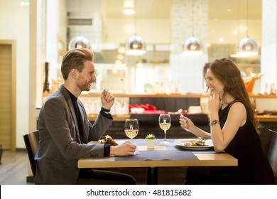 Young couple in the restaurant and have a romantic dinner