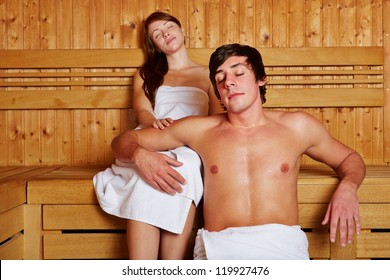 Young couple resting in a hotel sauna in the holidays