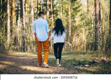 A young couple is resting on nature.