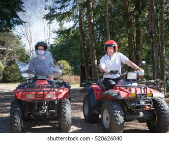 young couple riding a quad vehicle