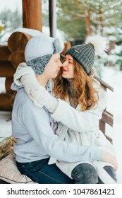 Young couple in a romantic cabin outdoors in winter