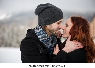 Young couple rubbing noses as a sign of love