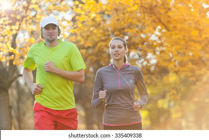 Young couple running in autumn season. Concept of fitness exercise and bidy training
