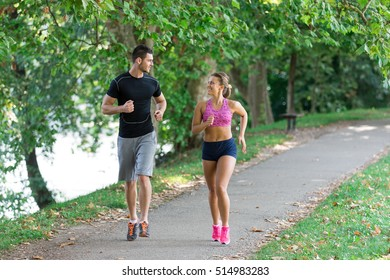 Young couple running in early morning at the park