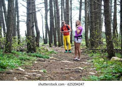 Young couple running on mountain trail
