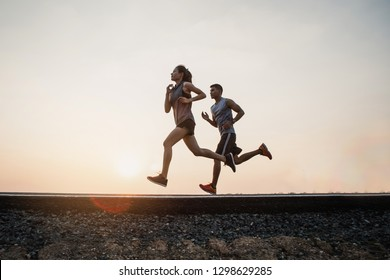 Young couple running on the street be running for exercise. fitness, sport, people, exercising ,running and lifestyle concept .