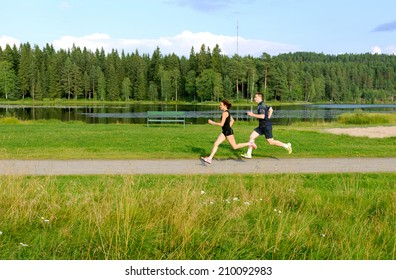 Young couple running outside