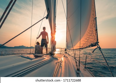 Young couple sailing on the boat at sunset - Shutterstock ID 1711722688