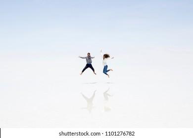 Young couple at Salar de uyuni salt flat in Bolivia