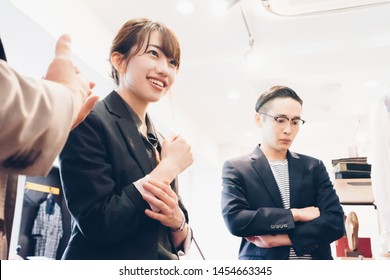 Young couple (sales, sales, shopping) listening to the product description